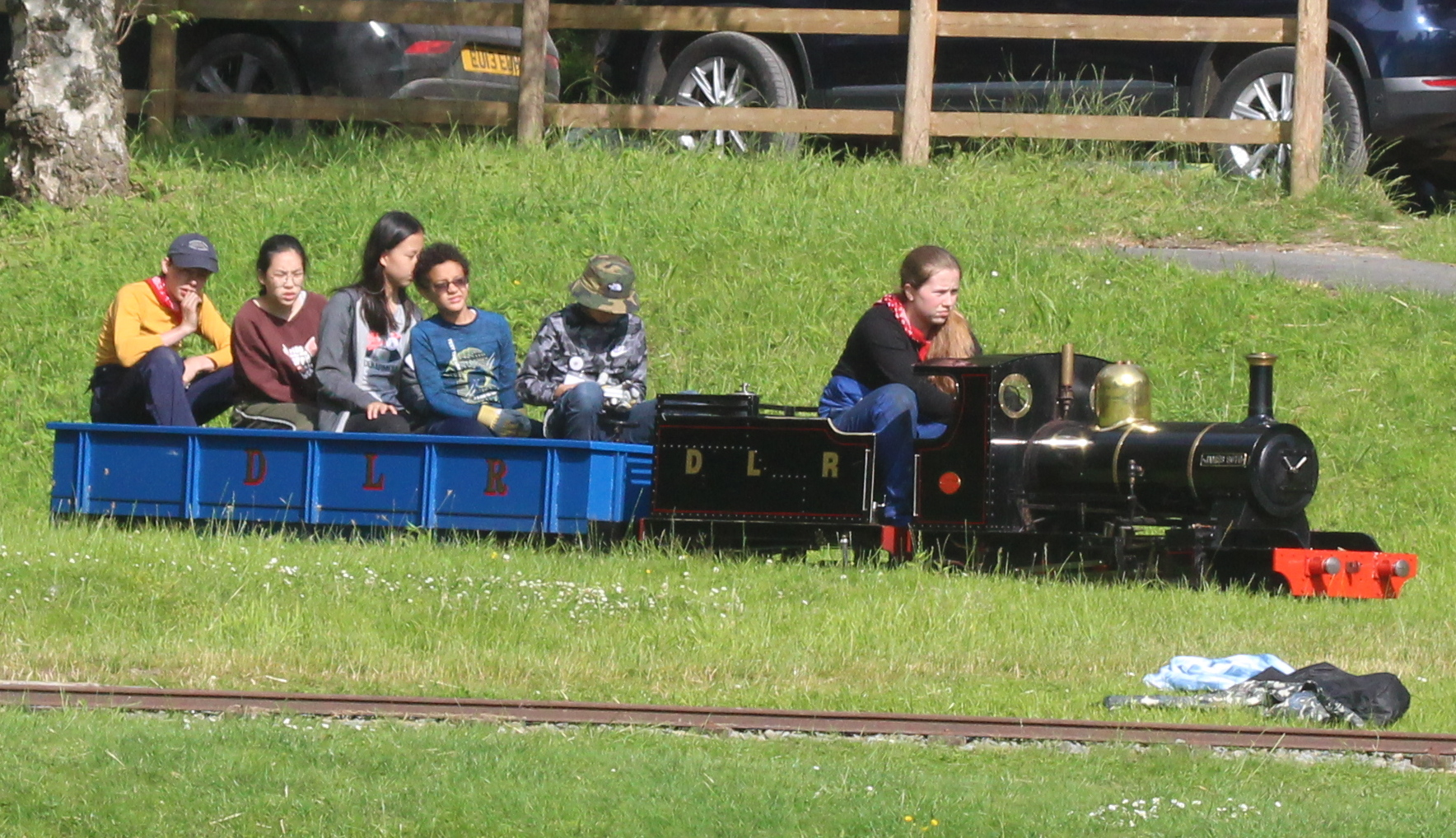Children taken for a ride in miniature steam train